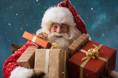 Image de Noël: Père Noël avec des cadeaux
