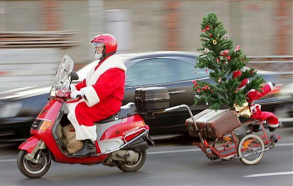 Image de Noël: Père Noël sur une moto
